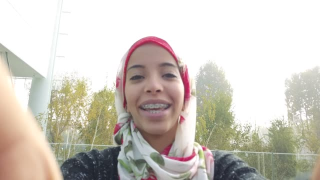 young arab woman having a video call - hijab stock videos & royalty-free footage
