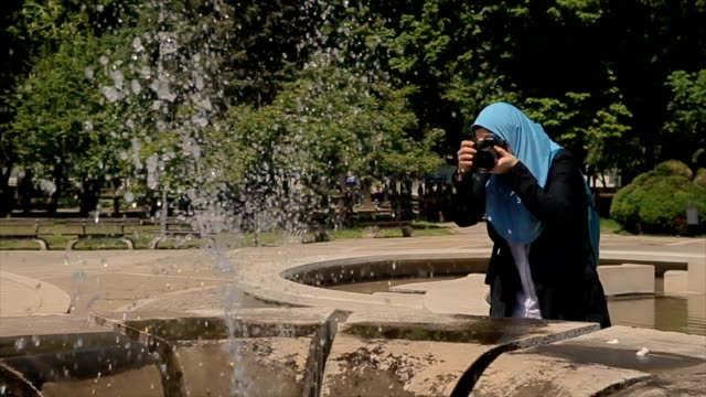 Young Arab woman professional photographer