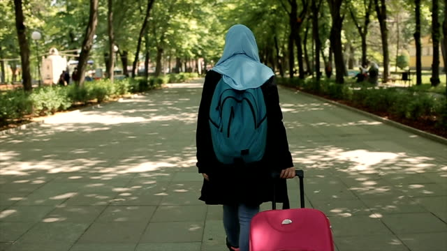 Young Arab woman travel with suitcase
