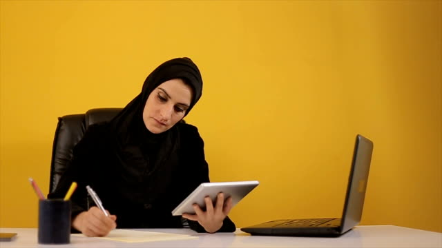 young arab woman using tablet in the office - qatar stock videos & royalty-free footage