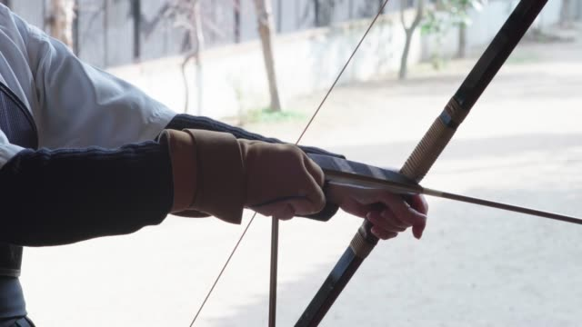 young archer practicing the japanese art of kyudo - arrow bow and arrow stock videos & royalty-free footage