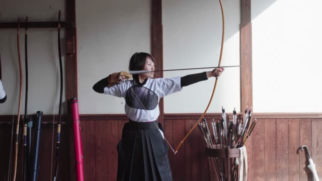 young archer practicing the japanese art of kyudo - tradition stock videos & royalty-free footage