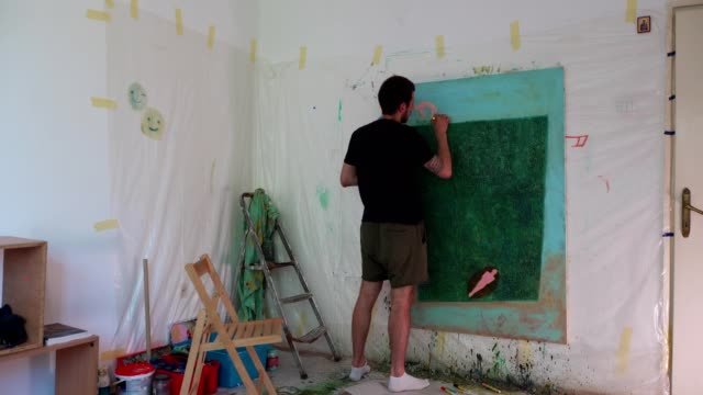 young artist painting a mural - decorating stock videos & royalty-free footage