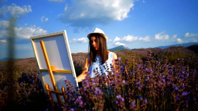 young artist painting an floral landscape - paintings stock videos and b-roll footage