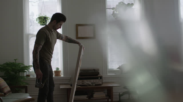 stockvideo's en b-roll-footage met ws slo mo. young artist places new blank canvas on apartment floor. - canvas