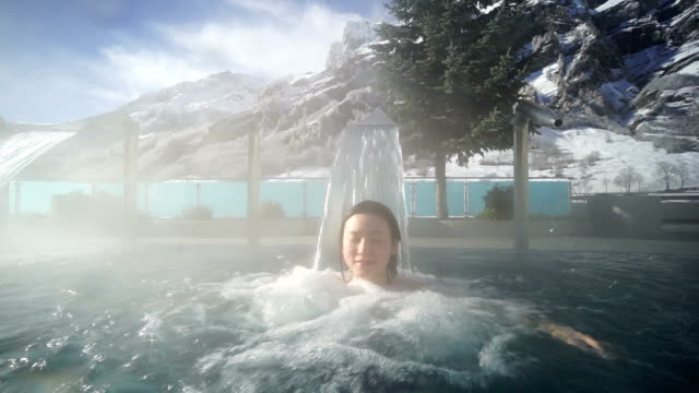 Young Asia woman enjoy hot spring in Switzerland