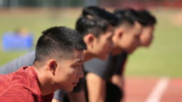 young asian adult sprinters on starting line