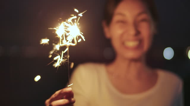 young asian beautiful woman holding sparklers - hope stock videos & royalty-free footage