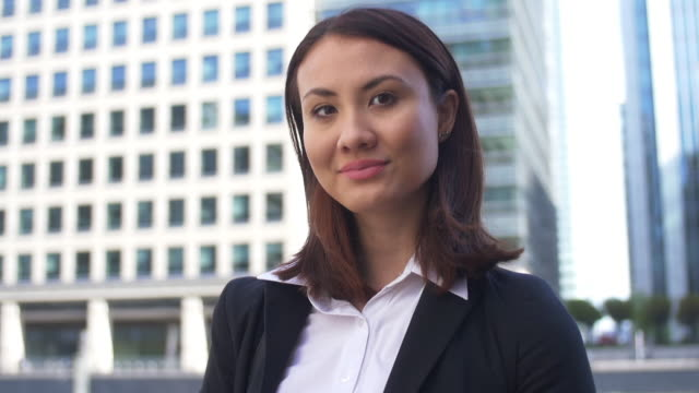 Young Asian Business Woman. Confident portrait to camera.