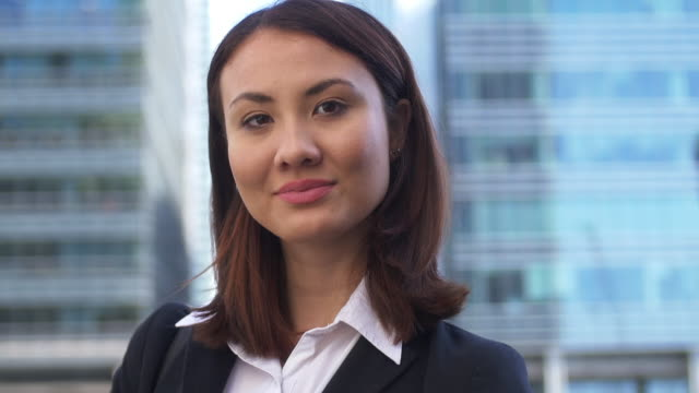 Young Asian Business Woman.Confident portrait to camera.
