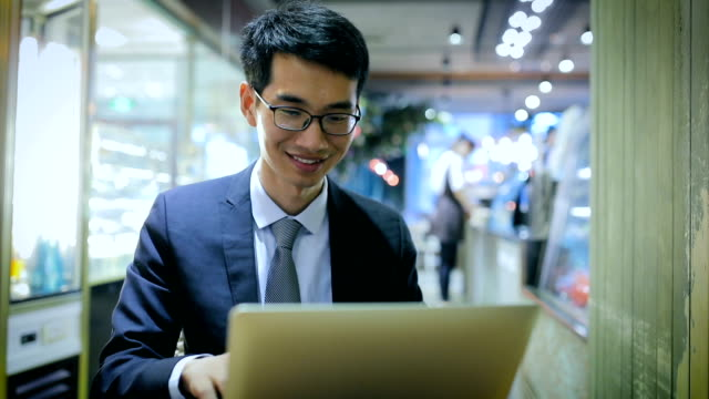 young asian businessman working on laptop - technophile stock videos & royalty-free footage