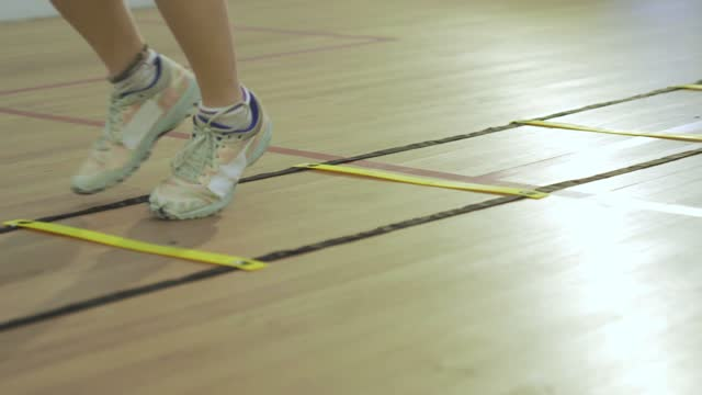 young asian chinese teenage girl athlete legs moving zigzag stepping warm up exercise before playing squash - zigzag stock videos & royalty-free footage