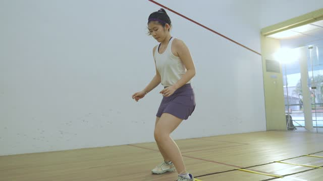 young asian chinese teenage girl athlete moving zigzag warm up exercise before playing squash - zigzag stock videos & royalty-free footage