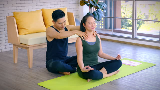 young asian couple exercising yoga together at home young wife and husband do sport training together in living room, happy asian couple meditating by exercising yoga at apartment. - bodyweight training stock videos & royalty-free footage