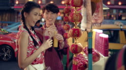 Young asian couple having buy juice water.