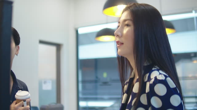 young asian couple of business people at a creative office - sticky stock videos & royalty-free footage