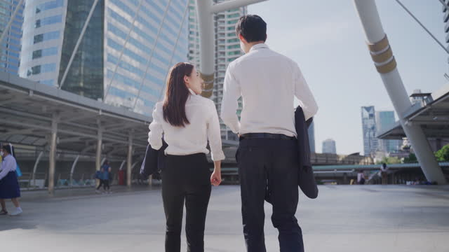 young asian coworker talk and advice together at office - greeting stock videos & royalty-free footage