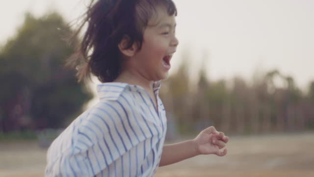 young asian family happiness on the beach - non urban scene stock videos & royalty-free footage