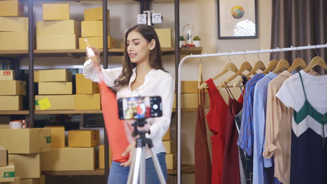 young asian female freelancer  selling clothes online by streaming. selling it online live streaming concept. - live broadcast stock videos & royalty-free footage