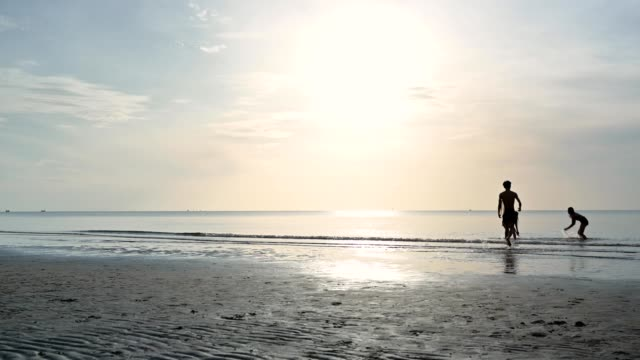 young asian friends splashing and running up to picking surfboard on the beach - plank stock videos & royalty-free footage