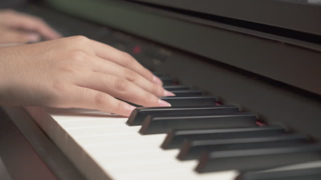 young asian girl hand practice on her piano lesson - piano stock videos & royalty-free footage