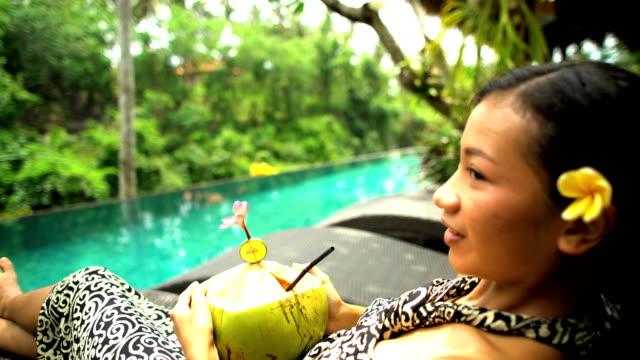 Young Asian girl relaxing at tropical resort Bali