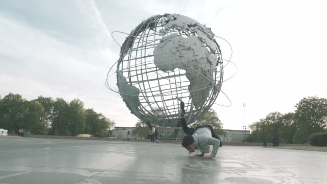 a young asian man break dances in flushing queens, nyc - 4k - kunst, kultur und unterhaltung stock-videos und b-roll-filmmaterial