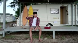 Young asian man drinking hot coffee and gas stove at camper van on weekend