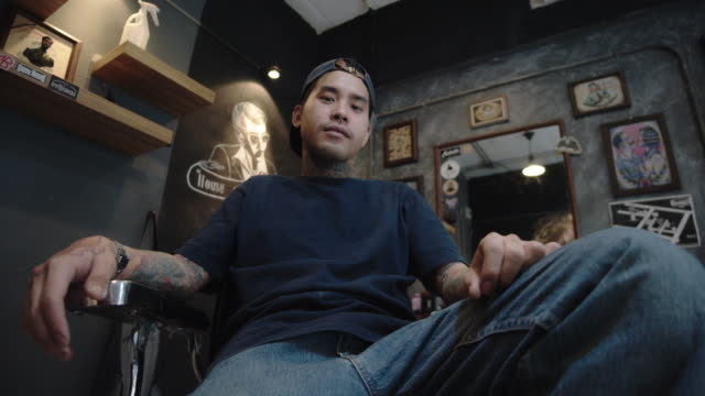 young asian man owner the barber shop. - barber stock videos & royalty-free footage