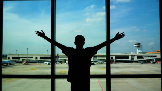 young asian man say hi , hello , good morning or good bye and wave his hand in the background of a airport , planes, concept: new business, travel, communication. - greeting stock videos & royalty-free footage