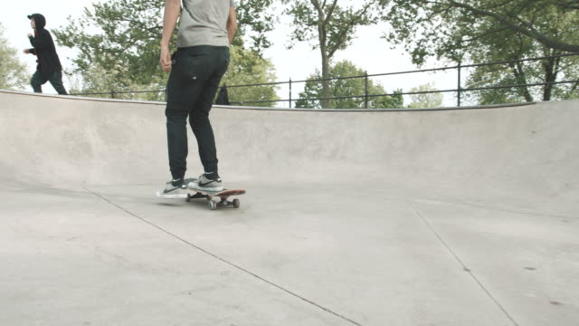 a young asian man skateboards in queens, nyc - 4k - slow motion - sports ramp stock videos and b-roll footage