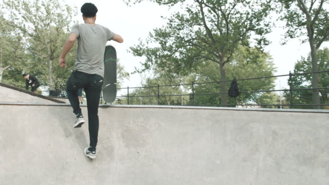 A young Asian man skateboards in Queens, NYC - 4k - slow motion