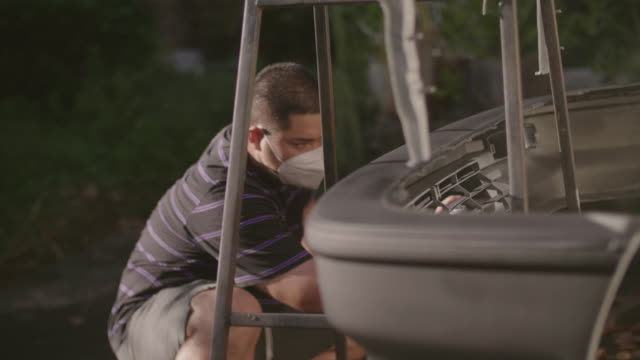 young asian man spray paint front bumper of a car. - bumper stock videos & royalty-free footage