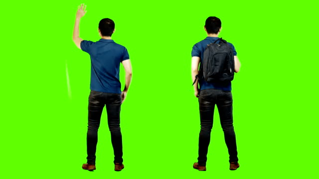 young asian mans from the back,green background. - stand stock videos & royalty-free footage