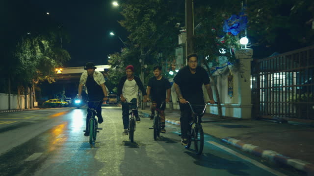 young asian men group with bicycle. - giovane adulto video stock e b–roll