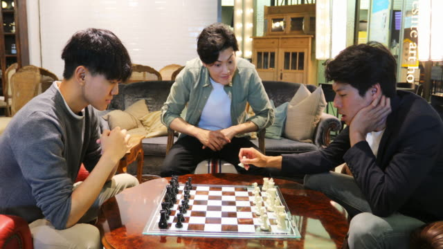 young asian men playing chess - game night leisure activity stock videos & royalty-free footage