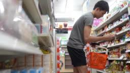 Young asian men shopping at shopping mall