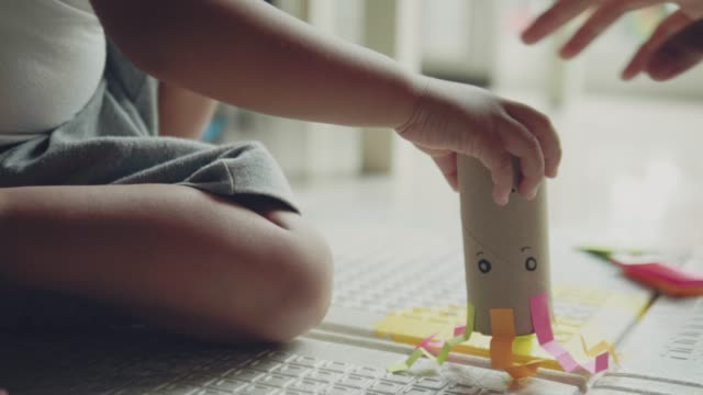young asian mother and son making toy with paper craft - art and craft stock videos & royalty-free footage