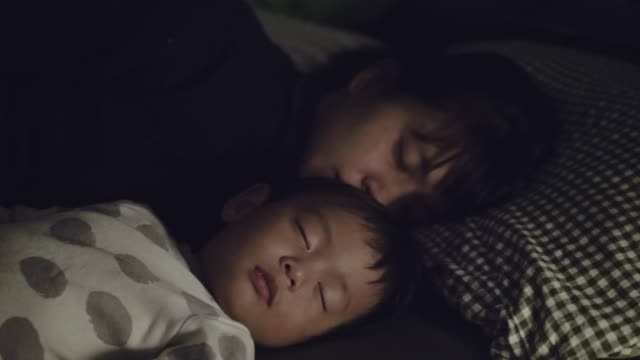 young asian mother cuddling her son at home. - 12 23 months stock videos & royalty-free footage