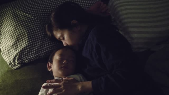young asian mother cuddling her son at home. - midnight stock videos & royalty-free footage
