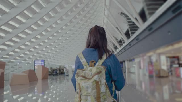 young asian mother walking with baby stroller at the airport. - rear view stock videos & royalty-free footage