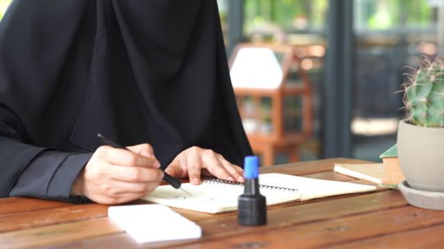 young asian muslim woman handwriting arab caligraphy - skill stock videos & royalty-free footage