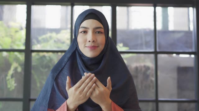 young asian muslim woman praying to god. - eid mubarak stock videos & royalty-free footage