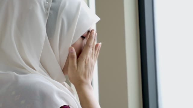 young asian muslim woman praying to god - eid mubarak stock videos & royalty-free footage
