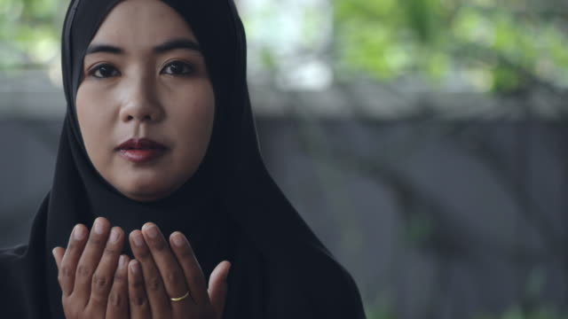 young asian muslim woman praying to god - praying stock videos & royalty-free footage