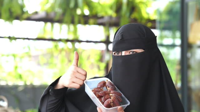 young asian muslim women online shopping dates fruit , ramadan at home , good condition , thumbs up - good condition stock videos & royalty-free footage