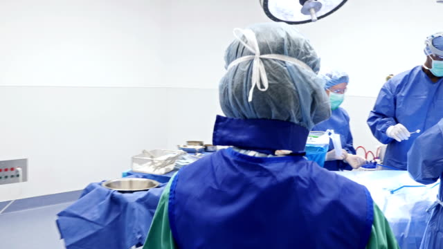 young asian nurse is carrying medical specimen - glove stock videos & royalty-free footage