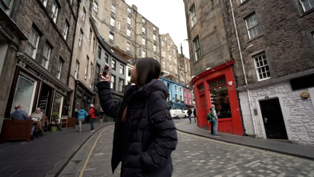 young asian teenage girl tourist taking selfie pictures on vacation - edinburgh scotland stock videos & royalty-free footage