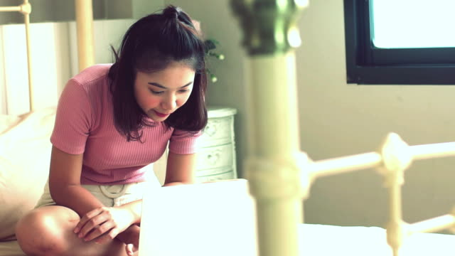 young asian teenager typing on a laptop - internet dating stock videos and b-roll footage