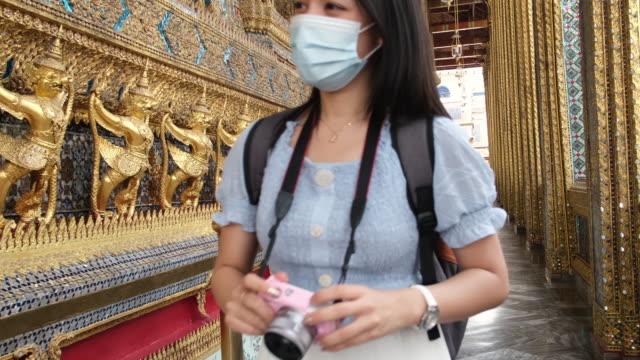 young asian tourist woman sightseeing at royal temple - bangkok stock videos & royalty-free footage